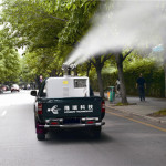 LR G machine spraying city tree